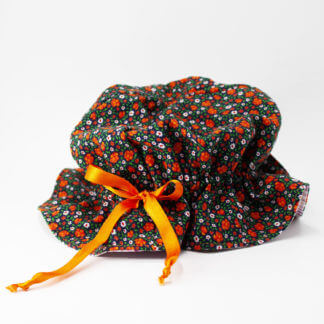 Cappello bimba a trama floreale